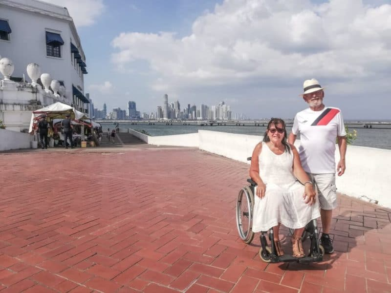 Panama City panorama with a couple and the woman in wheelchair