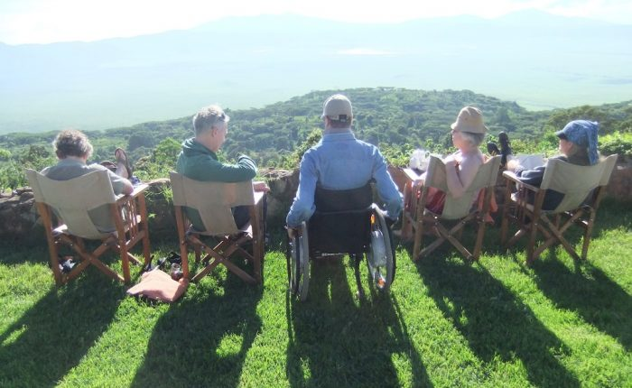 four gentlemen on the grass looking at the view of the Ngorongoro park