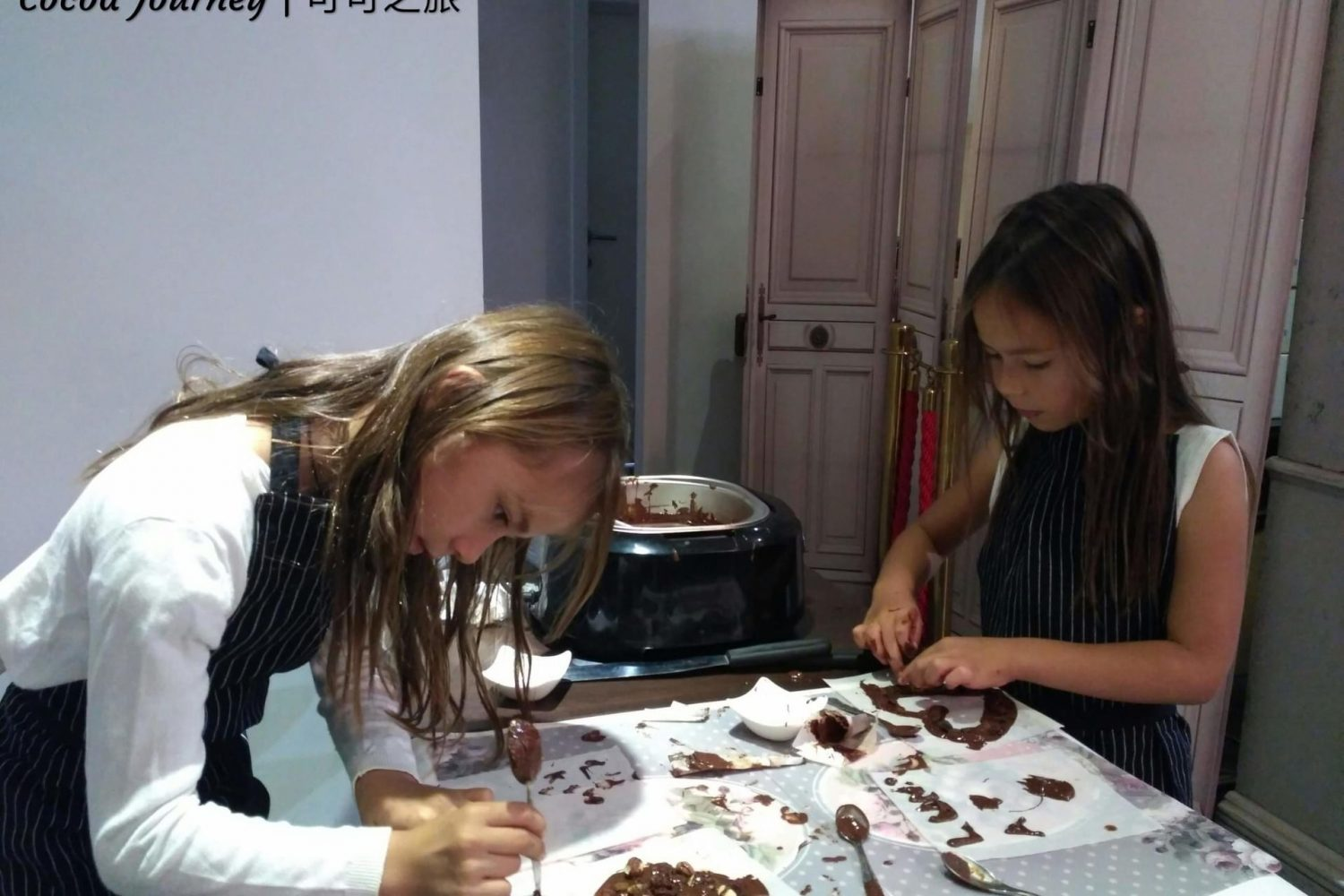 Girls making chocolate