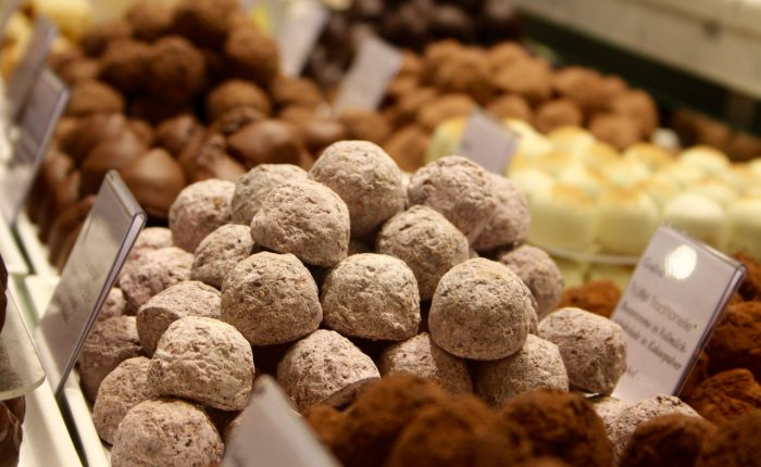 a lot of gourmet truffles of various colours and flavours