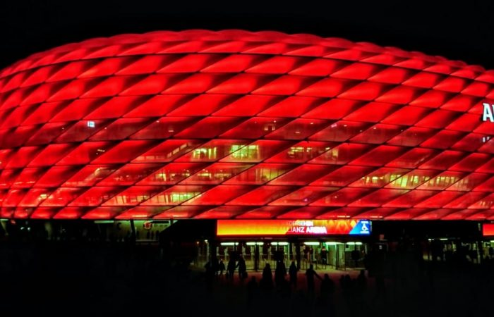 The Bayern Munich stadium at night all lit in red lights