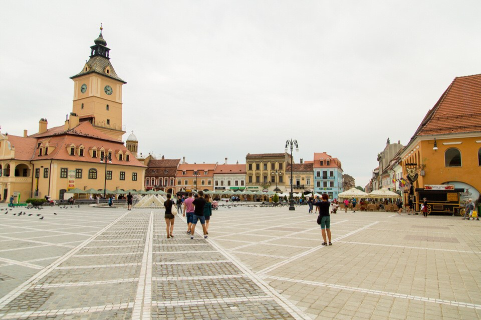 view of a square in Brasov with some people