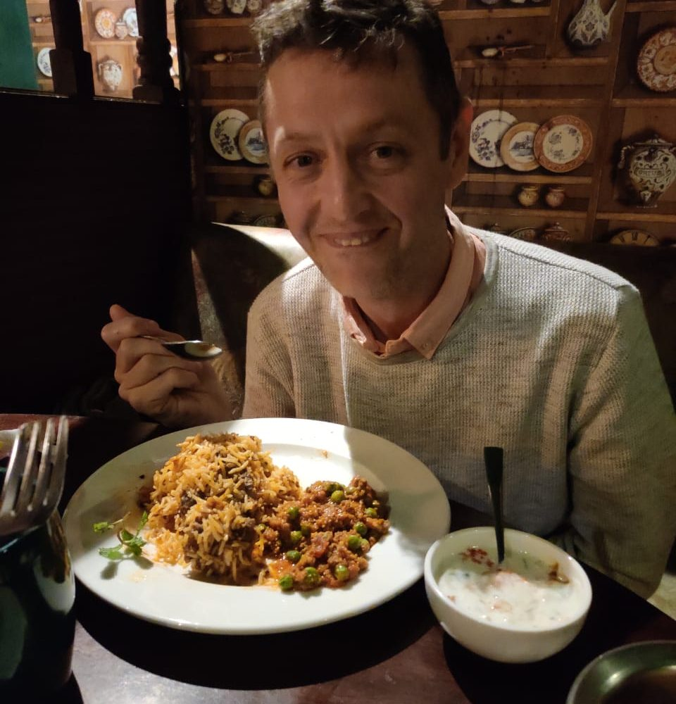 James exton of access the globe eating sri lankan food at a local restaurant