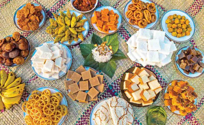 many many dishes of sri lankan sweets of all colours, shapes and textures